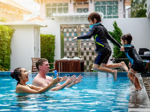 family-swimming-in-a-pool-EXPORT-600x450